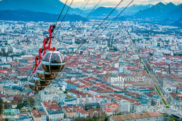 grenoble, france - bastille cable car with unrecognizable tourists reaching the top - isere stock pictures, royalty-free photos & images