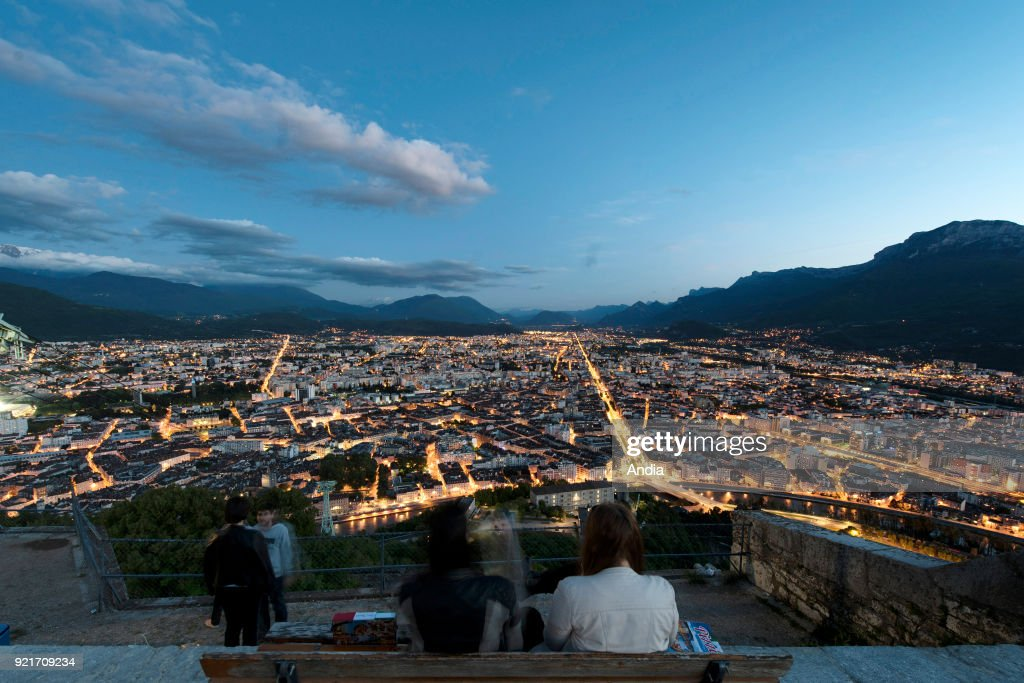 Grenoble (Rhone-Alpes region, south-eastern France): the city lit up at nightfall viewed from the Bastille Fortress.