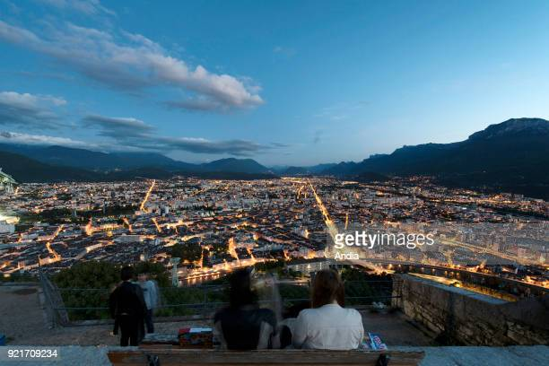 Grenoble the city lit up at nightfall viewed from the Bastille Fortress