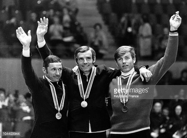 Grenoble Winter Olympics The awarding of the medal downhill race event From left to right the Frenchmen Guy PERILLAT JeanClaude KILLY and the Swiss...