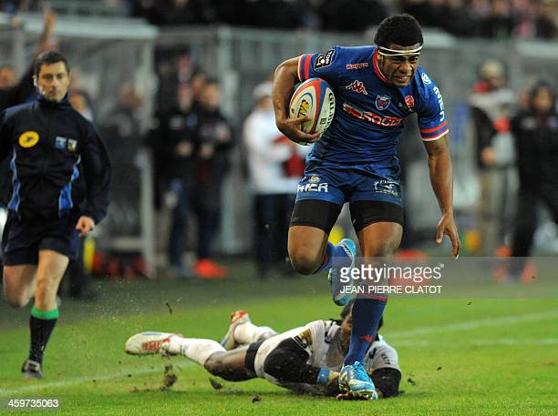 Grenoble's Fijian winger Alipate Ratini vies with Castres' English winger Marcel Garvey during the French Top 14 rugby union match Grenoble vs...