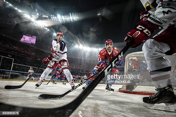 Grenoble's forward David Rodman and Lyon's defender Jacob Milovanovic vie for the puck during the French Ligue Magnus ice hockey match between Lyon...