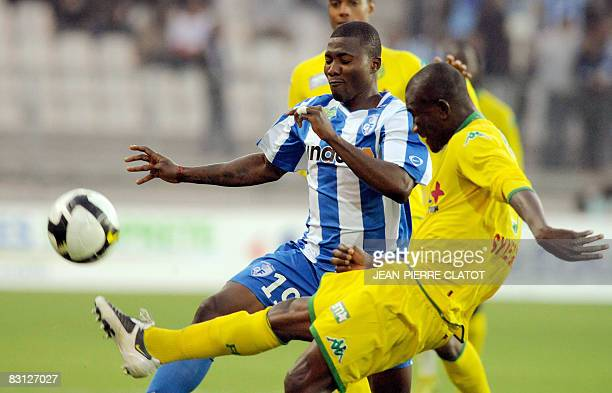 Grenoble's Franck Dja Dje Dje vies with Nantes' defender Remi Mareval during the French L1 football match Grenoble vs Nantes on October 4 2008 at the...