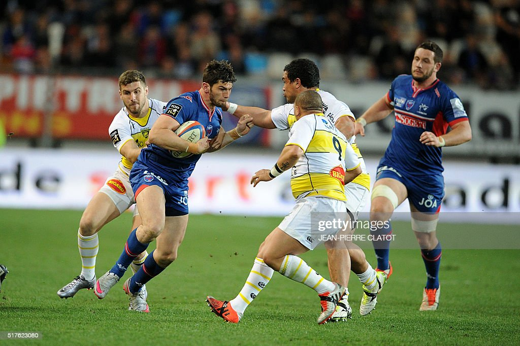Grenoble's French centre Xavier Mignot is tackled during the French Top 14 rugby union match Grenoble (FCG) vs La Rochelle (ASR) on March 26, 2016 at the Stade des Alpes in Grenoble.