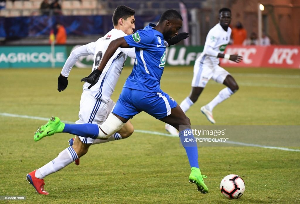 Grenoble's French defender Harouna Abou Demba vies with ...