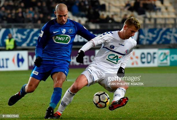 Grenoble's French defender Selim Bengriba vies with Strasbourg's French midfielder Jeremy Grimm during the French Cup football match between Grenoble...