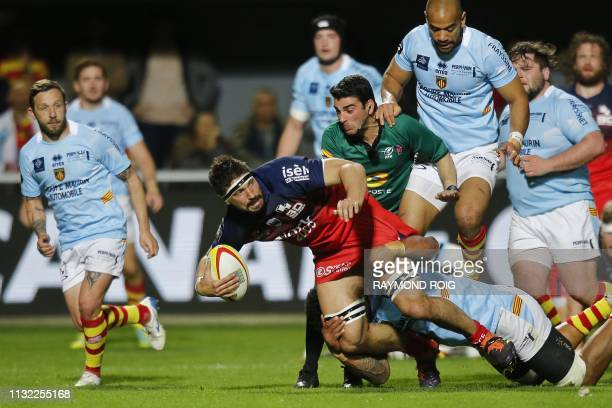 Grenoble's French flanker Clement Ancely is tackled during the French Top 14 Rugby Union match between Perpignan and Grenoble at the Aime Giral...