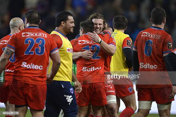 Grenoble's French flanker Fabien Alexandre celebrates with teammates after Grenoble won their French Top 14 rugby union match against Clermont...