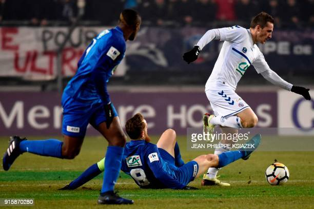 Grenoble's French midfielder Julien Deletraz vies with Strasbourg's French midfielder Dimitri Lienard during the French Cup football match between...