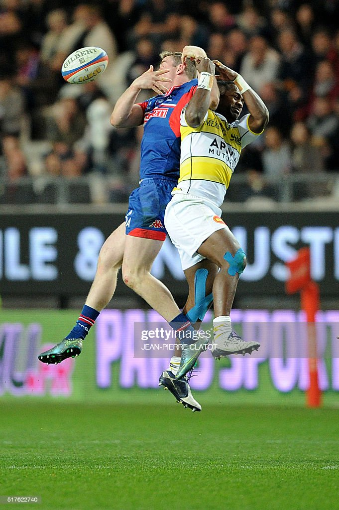 Grenoble's Irish centre Chris Farrell (L) vies with La Rochelle's Fijian fullback Kini Murimurivalu during the French Top 14 rugby union match Grenoble (FCG) vs La Rochelle (ASR) on March 26, 2016 at the Stade des Alpes in Grenoble.