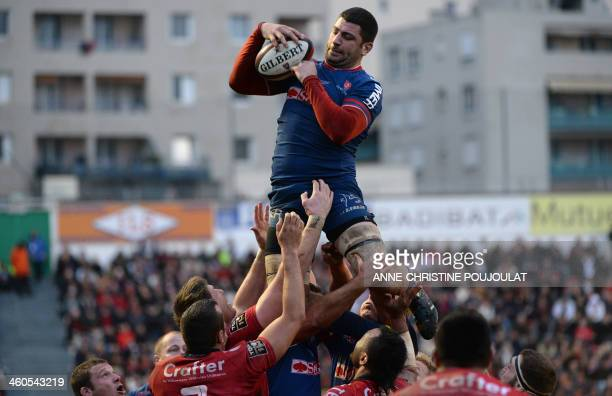Grenoble's Jonathan Best jumps for the ball during the French Top 14 rugby union match Toulon vs Grenoble at the Mayol stadium on January 4 2014 in...
