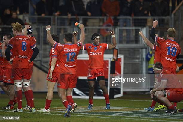 Grenoble's players celebrate after Grenoble won their French Top 14 rugby union match against Clermont Auvergne on February 14, 2014 at the Alpes...