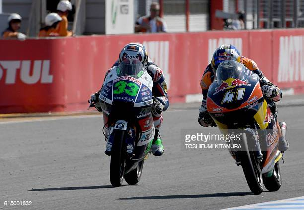 Gresini Racing Moto3's Italian rider Enea Bastianini goes sidebyside with Red Bull KTM Ajo's South African rider Brad Binder during the Moto3 race at...