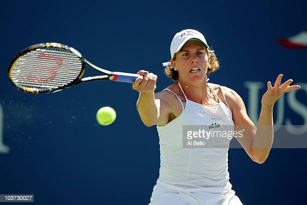 Greta Arn of Hungary returns a forehand against Kim Clijsters of Belgium during the Women's Singles first round match on day one of the 2010 US Open...