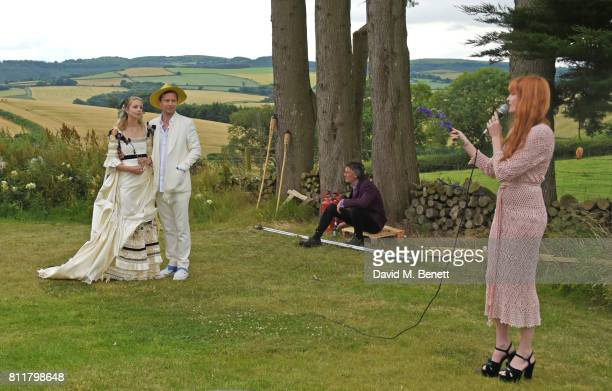 Greta Bellamacina and Robert Montgomery look on as Florence Welch performs at their wedding on July 8 2017 in Exeter England