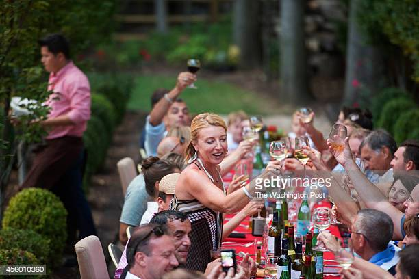 Greta De Keyser and Bart Vandaele and guests toast during an evening of entertainment and food and drink at their home in Alexandria Virginia on...