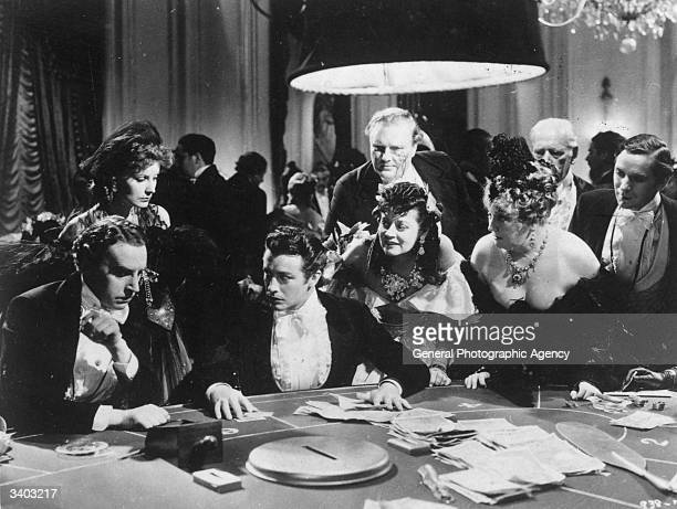 Greta Garbo and Robert Taylor in a casino scene from 'Camille' an MGM production directed by George Cukor