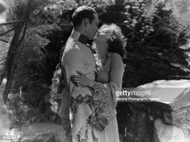 Greta Garbo shares a close embrace with actor Conrad Nagel in the spy drama 'Mysterious Lady' Title The Mysterious Lady Studio MGM Director Fred Niblo