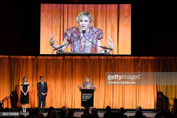 Greta Gerwig accepts an award onstage with Stephen Colbert during the National Board of Review Annual Awards Gala at Cipriani 42nd Street on January...