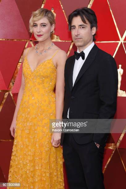 Greta Gerwig and Noah Baumbach attend the 90th Annual Academy Awards at Hollywood Highland Center on March 4 2018 in Hollywood California