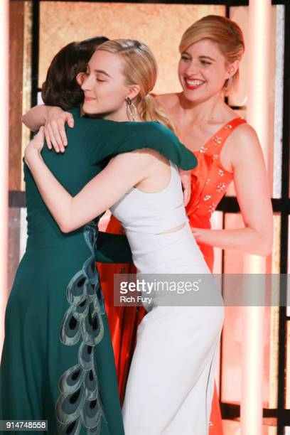 Greta Gerwig and Saoirse Ronan present Laurie Metcalf the award for Best Supporting Actress at AARP's 17th Annual Movies For Grownups Awards at the...