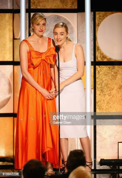 Greta Gerwig and Saoirse Ronan speak onstage during AARP's 17th Annual Movies For Grownups Awards at the Beverly Wilshire Four Seasons Hotel on...