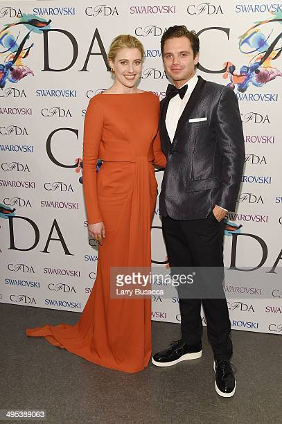 Greta Gerwig and Sebastian Stan attend the winners walk during the 2014 CFDA fashion awards at Alice Tully Hall Lincoln Center on June 2 2014 in New...