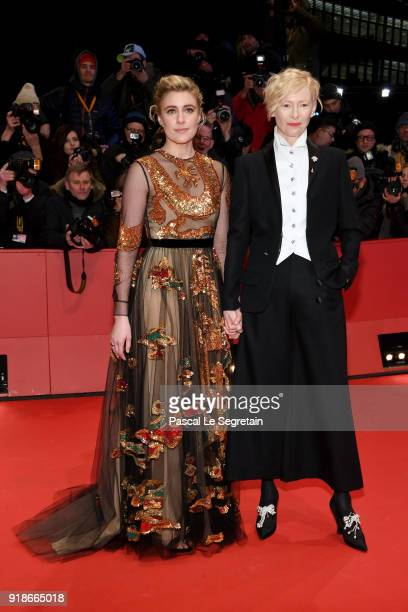 Greta Gerwig and Tilda Swinton wearing Chanel attend the Opening Ceremony 'Isle of Dogs' premiere during the 68th Berlinale International Film...
