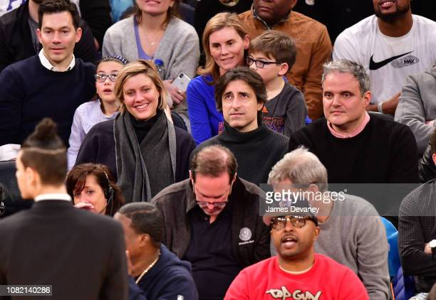 Greta Gerwig Noah Baumbach and guest attend Philadelphia 76ers v New York Knicks game at Madison Square Garden on January 13 2019 in New York City