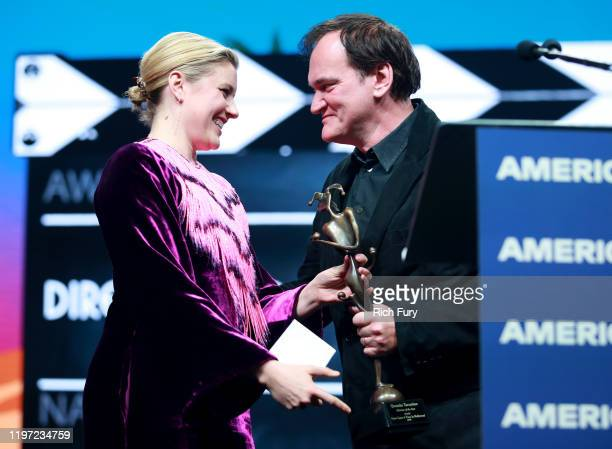 Greta Gerwig presents the Director of the Year award to Quentin Tarantino onstage during the 31st Annual Palm Springs International Film Festival...