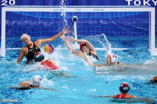 Greta Gurisatti of Team Hungary scores a goal past Eruna Ura , Minami Shioya and Marina Tokumoto of Team Japan during the Women's Preliminary Round...