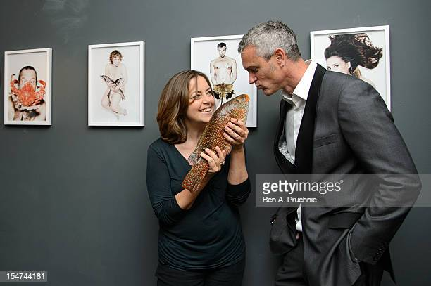 Greta Scacchi and Mark Foster attend a photocall ahead of the private view of Rankin Fishlove on October 25 2012 in London England