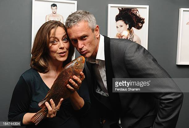 Greta Scacchi and Mark Foter attend a photocall ahead of the private view of Rankin Fishlove on October 25 2012 in London England