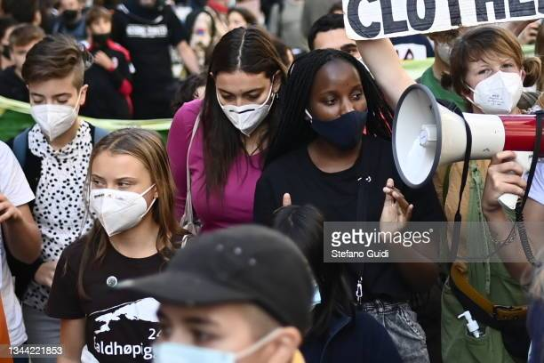 Greta Thunberg and Vanessa Nakate walk with Fridays For Future activists during a climate strike march on October 1, 2021 in Milan, Italy. On the...