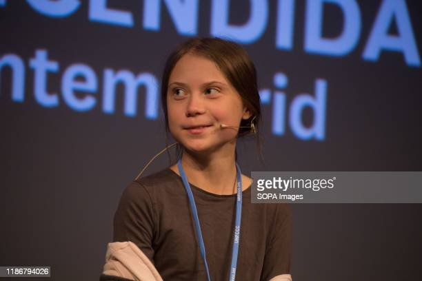 Greta Thunberg smiles during a press conference. Press conference of the Swedish activist of Fridays for Future, climate change, Greta Thunberg after...