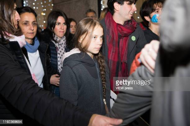 Greta Thunberg, surrounded by other activists, heads towards of the Climate March on December 6, 2019 in Madrid, Spain. Shortly after reaching the...