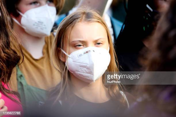 Greta Thunberg walks with Fridays For Future activists during a climate strike march on October 1, 2021 in Milan, Italy