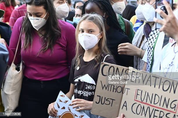 Greta Thunberg walks with Fridays For Future activists during a climate strike march on October 1, 2021 in Milan, Italy. On the sidelines of various...