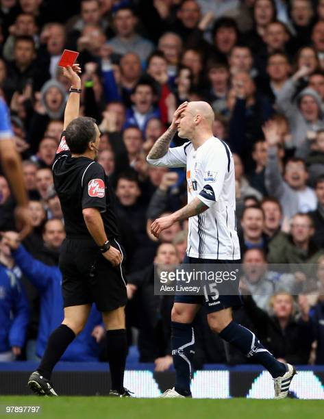 Gretar Steinsson of Bolton Wanderers is sent off by referee Alan Wiley during the Barclays Premier League match between Everton and Bolton Wanderers...