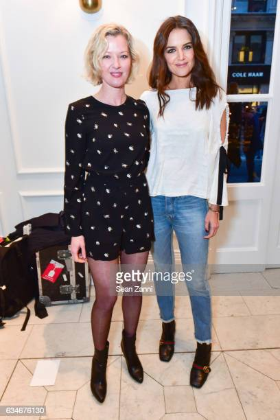 Gretchen Mol and Katie Holmes arrive at the Club Monaco show during New York Fashion Week at Club Monaco Fifth Avenue on February 10 2017 in New York...
