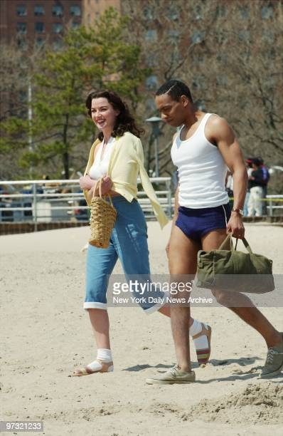Gretchen Mol and Kevin Carroll stroll the beach at Coney Island while filming a scene for the TV movie The Ballad of Bettie Page Mol plays the title...