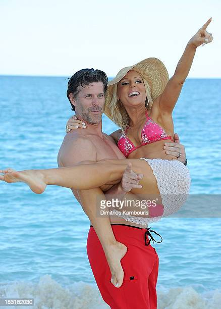 Gretchen Rossi and Slade Smiley enjoy the beach at Sandals Emerald Bay after the Golf Clinic with Greg Norman and Golf Tournament during Day Three of...