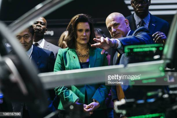 Gretchen Whitmer governor of Michigan center views the Aisin Group imobility display during the 2019 North American International Auto Show in...