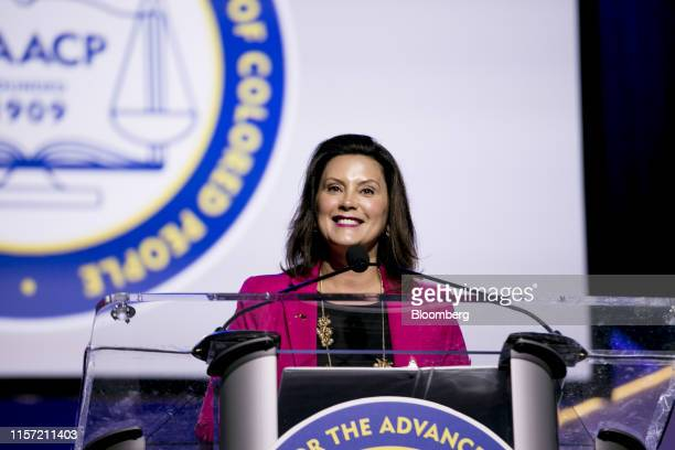 Gretchen Whitmer governor of Michigan smile while speaking during the 110th NAACP Annual Convention in Detroit Michigan US on Monday July 22 2019...