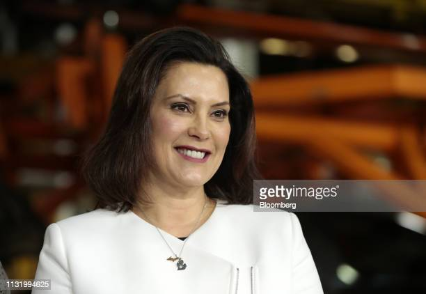 Gretchen Whitmer, governor of Michigan, smiles during an event at the General Motors Co. Orion Assembly plant in Orion Township, Michigan, U.S., on...