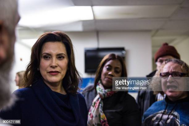 Gretchen Whitmer listens to longtime friend Bill Baldridge at the United Precinct Delegates office on W McNichols Rd in Detroit Michigan on December...