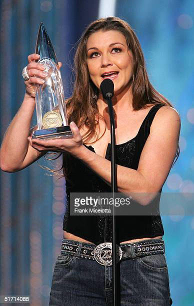 Gretchen Wilson accepts her Horizon Award on stage at the 38th Annual CMA Awards at the Grand Ole Opry House November 9 2004 in Nashville Tennessee
