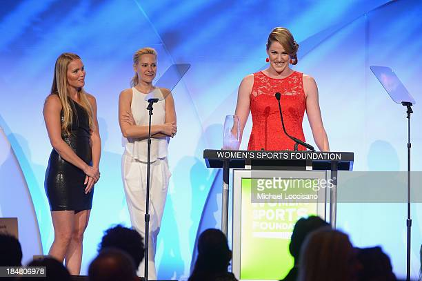 Grete Eliassen and Aimee Mullins present Olympic gold medalist Missy Franklin with the Individual Sports Woman of the Year Award onstage during the...