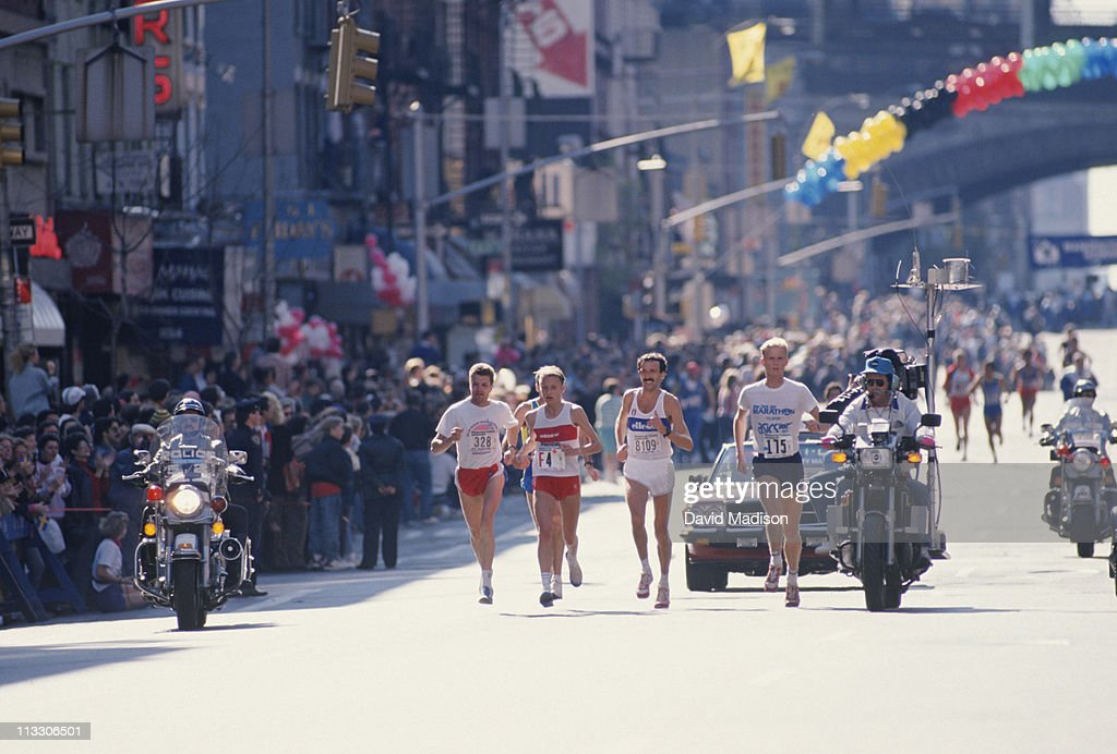 Grete Waitz #F4 of Norway runs on 1st Avenue in Manhattan on her way to winning the 1988 New York City marathon held on November 6, 1988 in New York City.