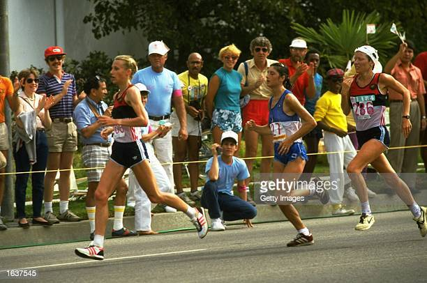 Grete Waitz of Norway leads from Laura Fogli of Italy and Ingrid Kristiansen of Norway during the Marathon event at the 1984 Olympic Games at the...